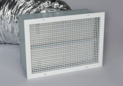 A photo of the damper box and grille of a QA-Deluxe Whole House Fan.