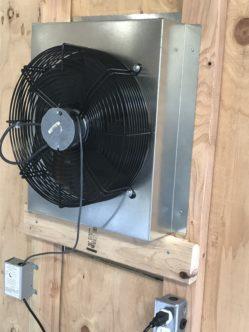 A closeup photo of an installed Centric Air Attic Fan.